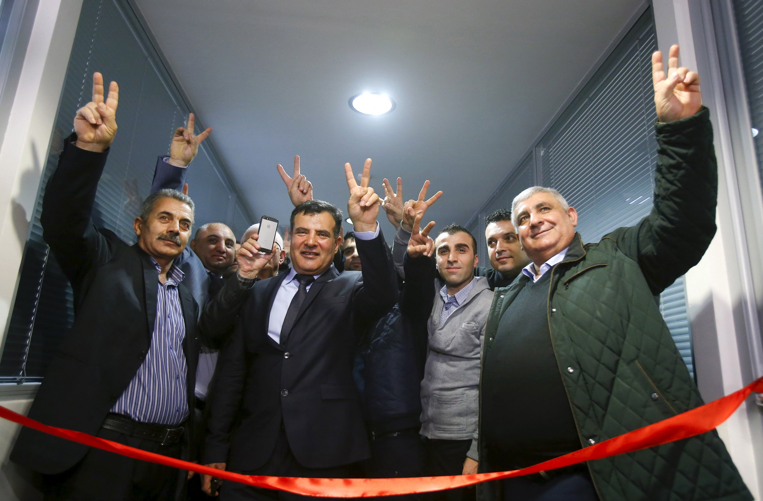 Syrian Kurdish activists cut the ribbon