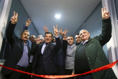 Syrian Kurdish activists cut the ribbon