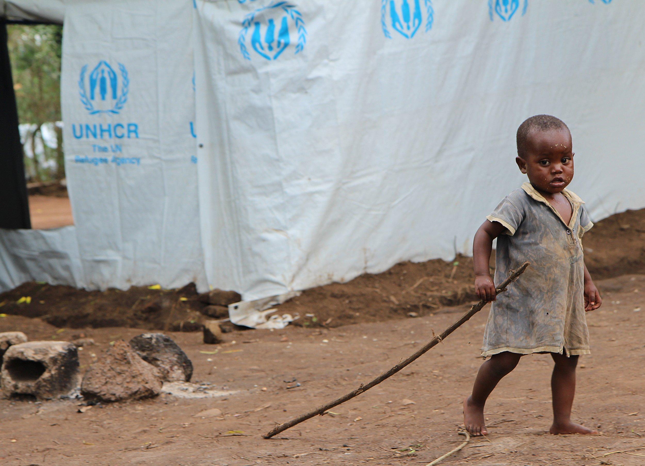A Burundian refugee plays in a Rwandan refugee camp.
