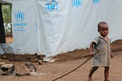 A Burundian refugee plays in a Rwandan refugee camp.