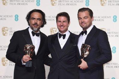 Alejandro Inarritu and Leonardo DiCaprio show off their awards with Tom Cruise.
