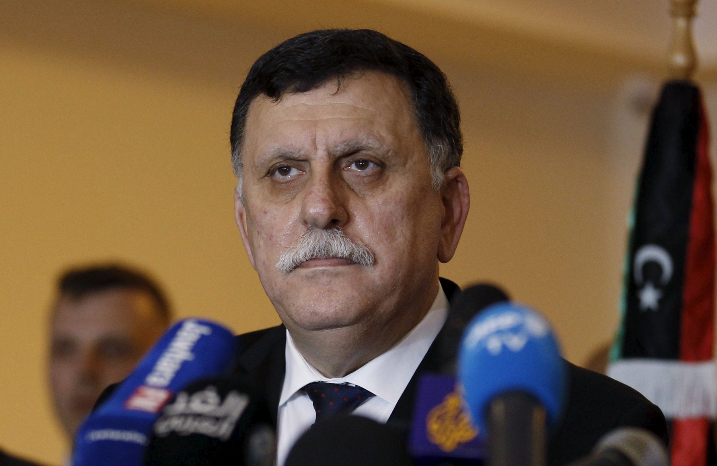 Libyan Prime Minister-designate Fayez Seraj attends a news conference in Tunis.