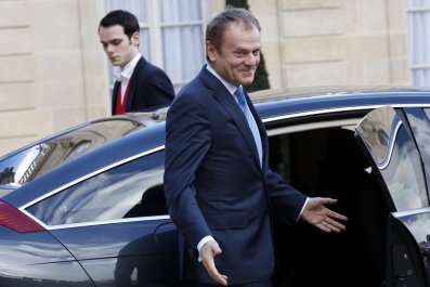 EU Council President Donald Tusk leaves the Elysee Palace in Paris.