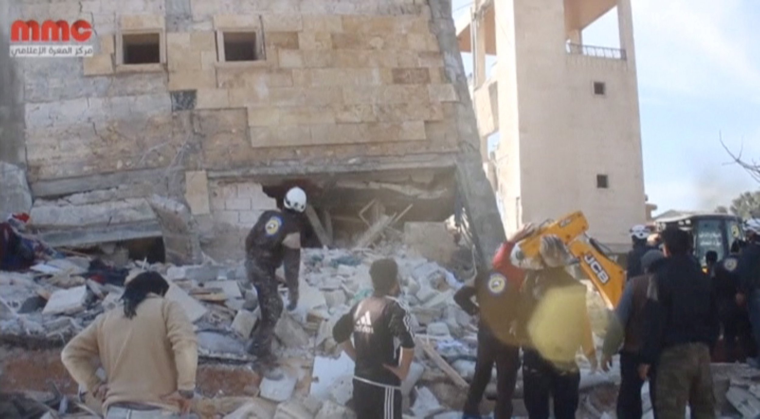 People gather near an MSF-supported hospital in Idlib, which was reportedly hit by airstrikes.