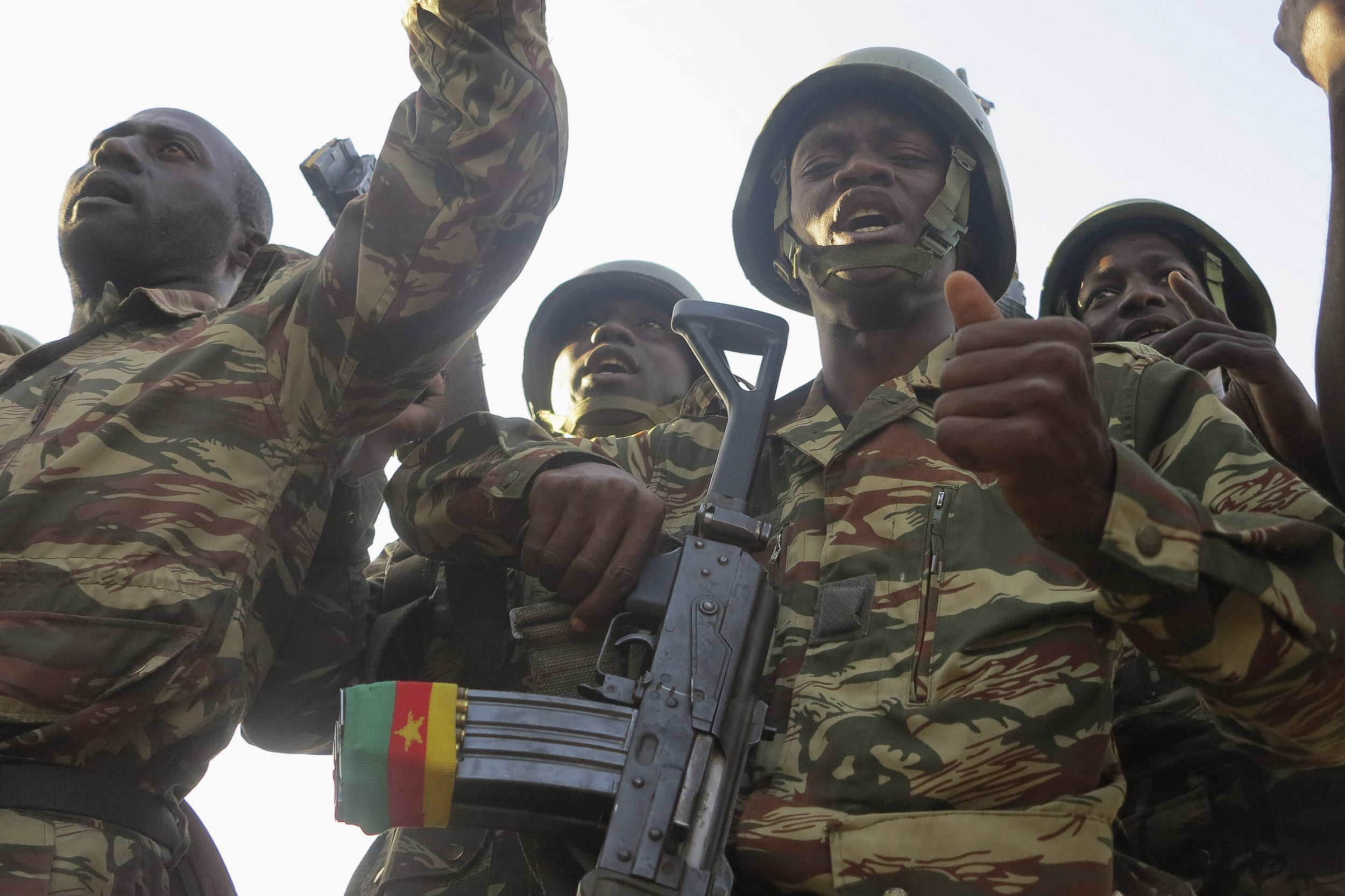 Cameroonian soldiers sing and dance.