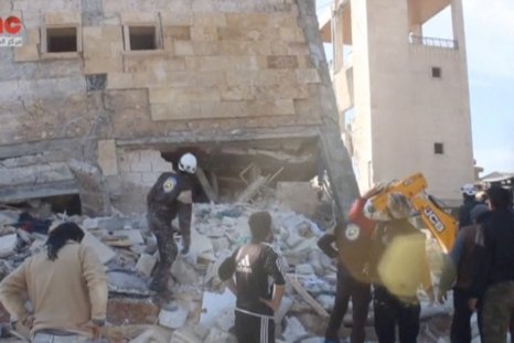People walk on the rubble of an MSF hospital