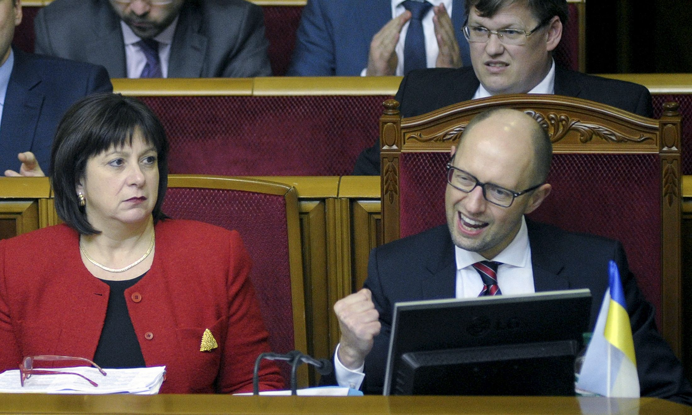 Yatsenyuk punches the air in celebration in parliament