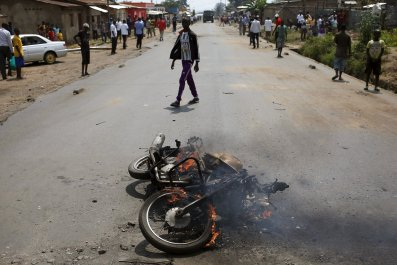 A motorbike is seen burning in Bujumbura, Burundi.