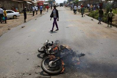 A motorbike is seen burning in Bujumbura, Burundi.