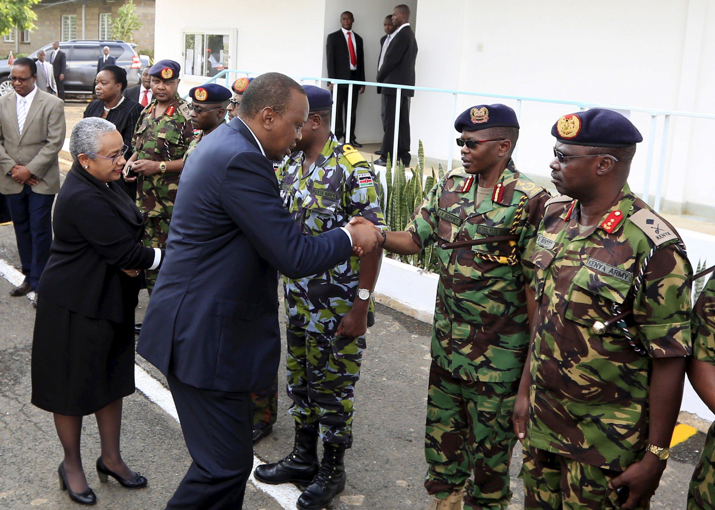 Uhuru Kenyatta greets military officers after Al-Shabab attack.