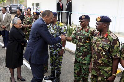 Uhuru Kenyatta greets military officers after Al-Shabab attack.