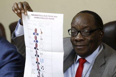 Uganda's head of electoral commission Badru Kiggundu with a list of candidates.