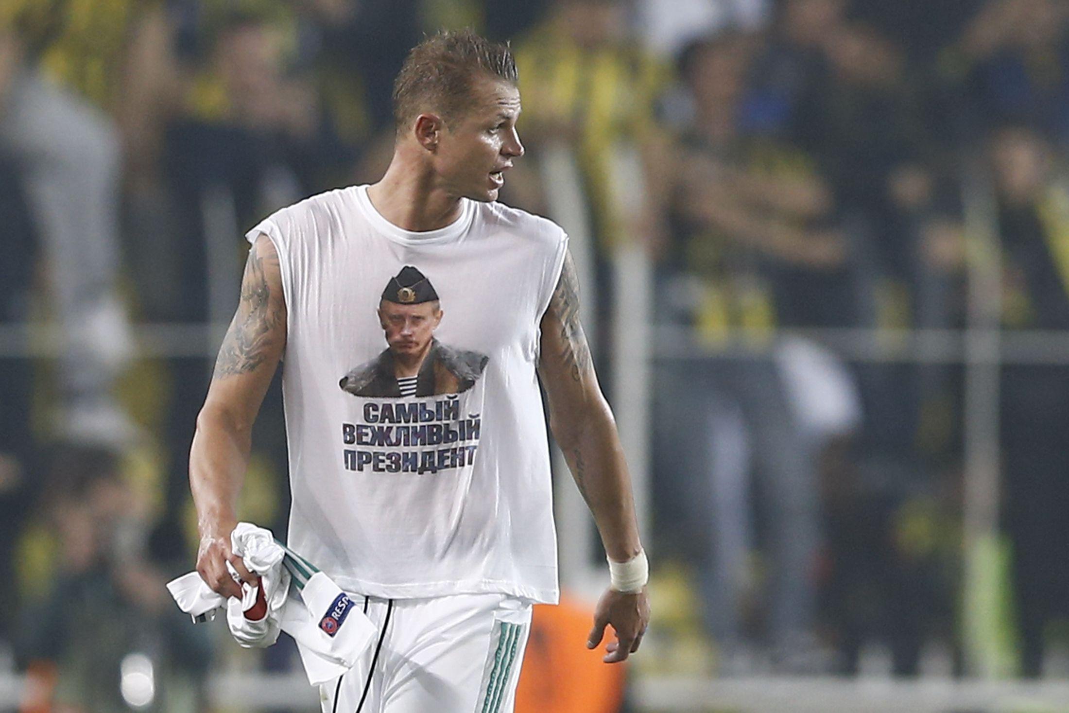Tarasov walks off the pitch with his Putin shirt