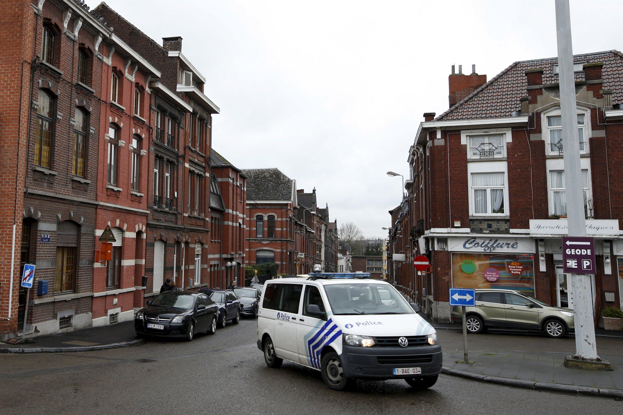 Police van waits on Belgian street