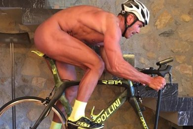 Mario Cipollini riding naked on his indoor bike.