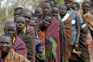 Ugandans wait to vote in Karamoja.