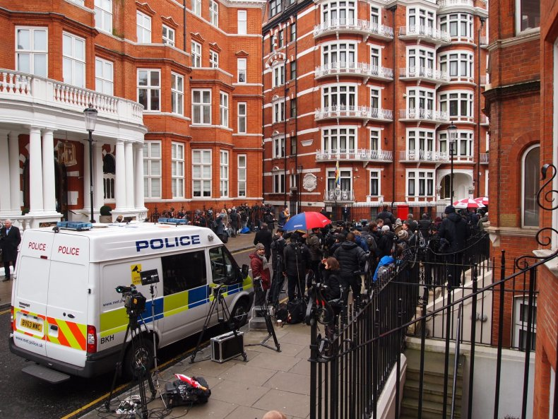 Assange embassy police and press gather outside