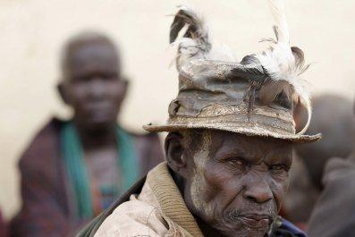 A Karamojong tribesman waits to vote in Uganda's elections.