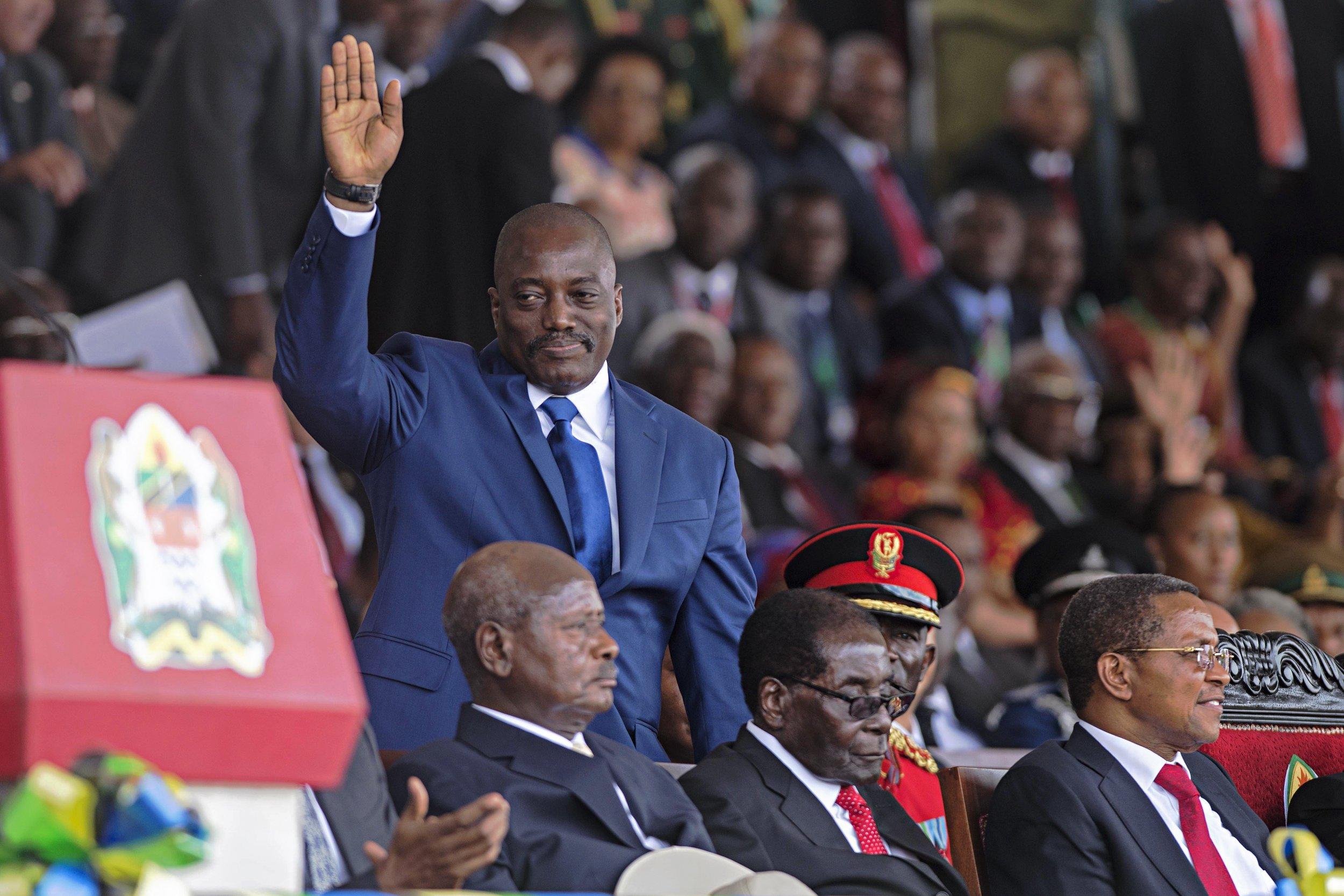 DRC President Joseph Kabila waves.
