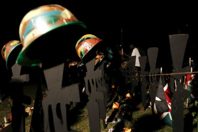 A memorial service for Kenyan soldiers killed in an Al-Shabab attack on an African Union base in Somalia.