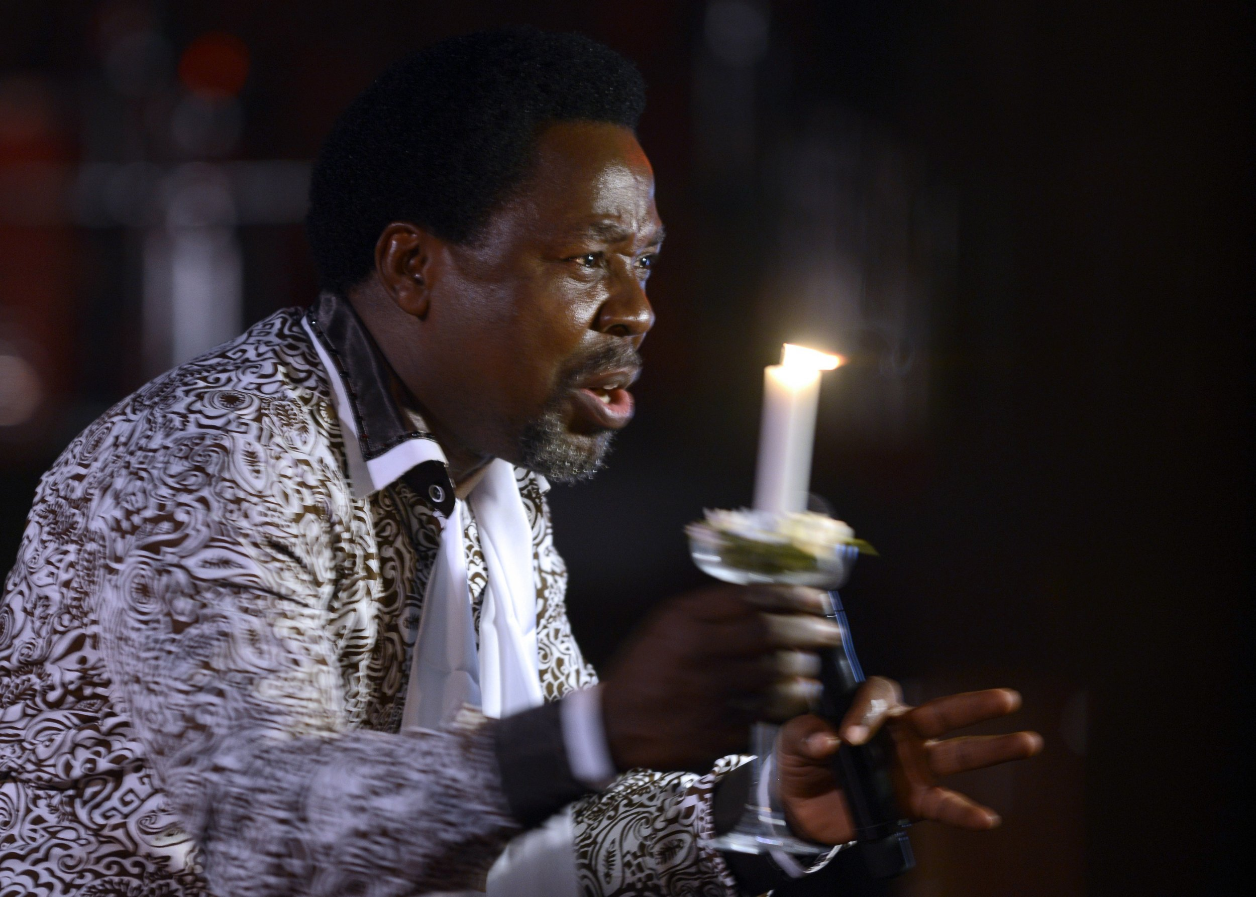 Nigerian pastor TB Joshua speaks at a memorial service.