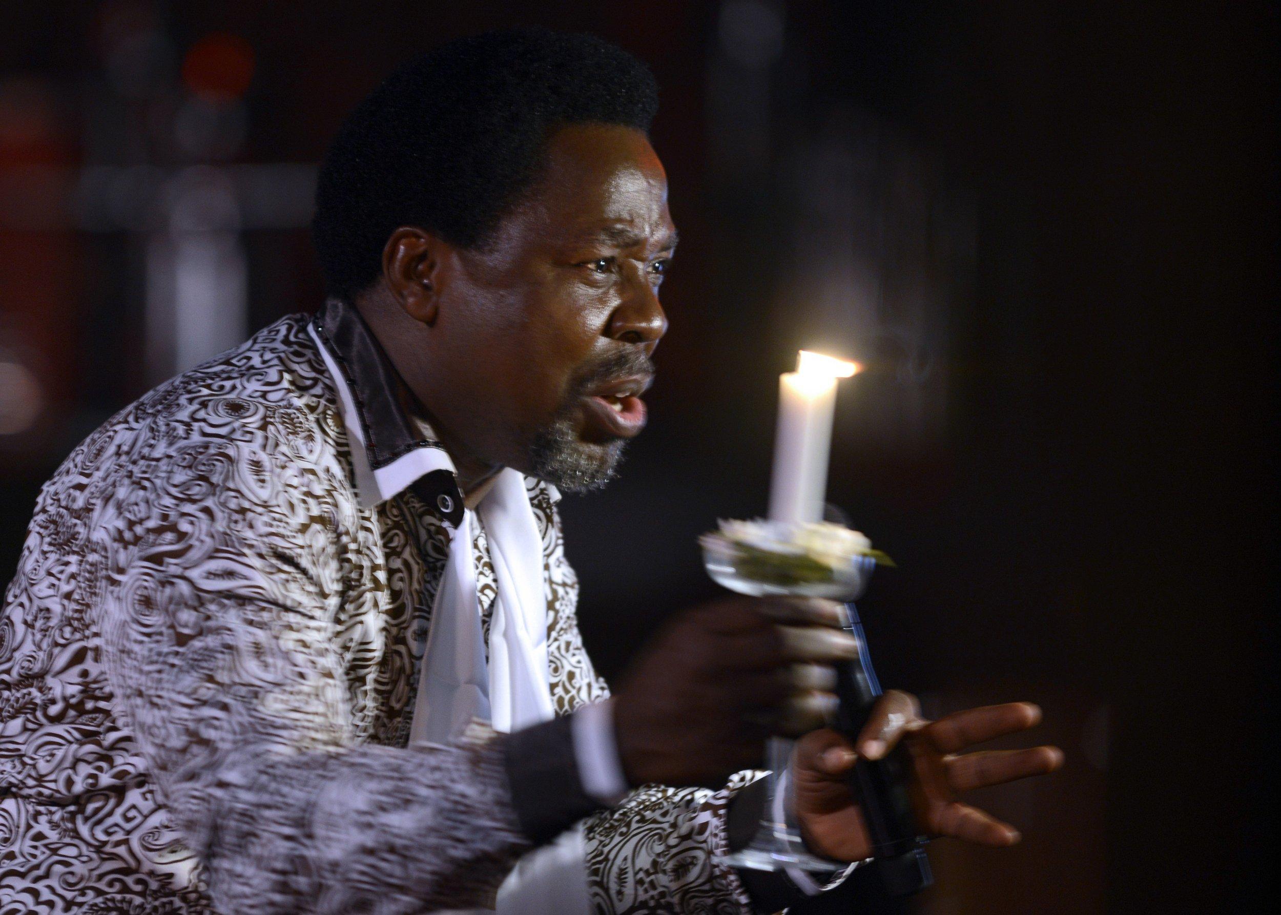 Nigerian pastor TB Joshua speaks at a memorial service.