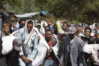 People mourn an alleged Oromo protester shot dead by Ethiopian security forces.