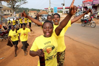 Yoweri Museveni supporters celebrate his election victory in Kampala.