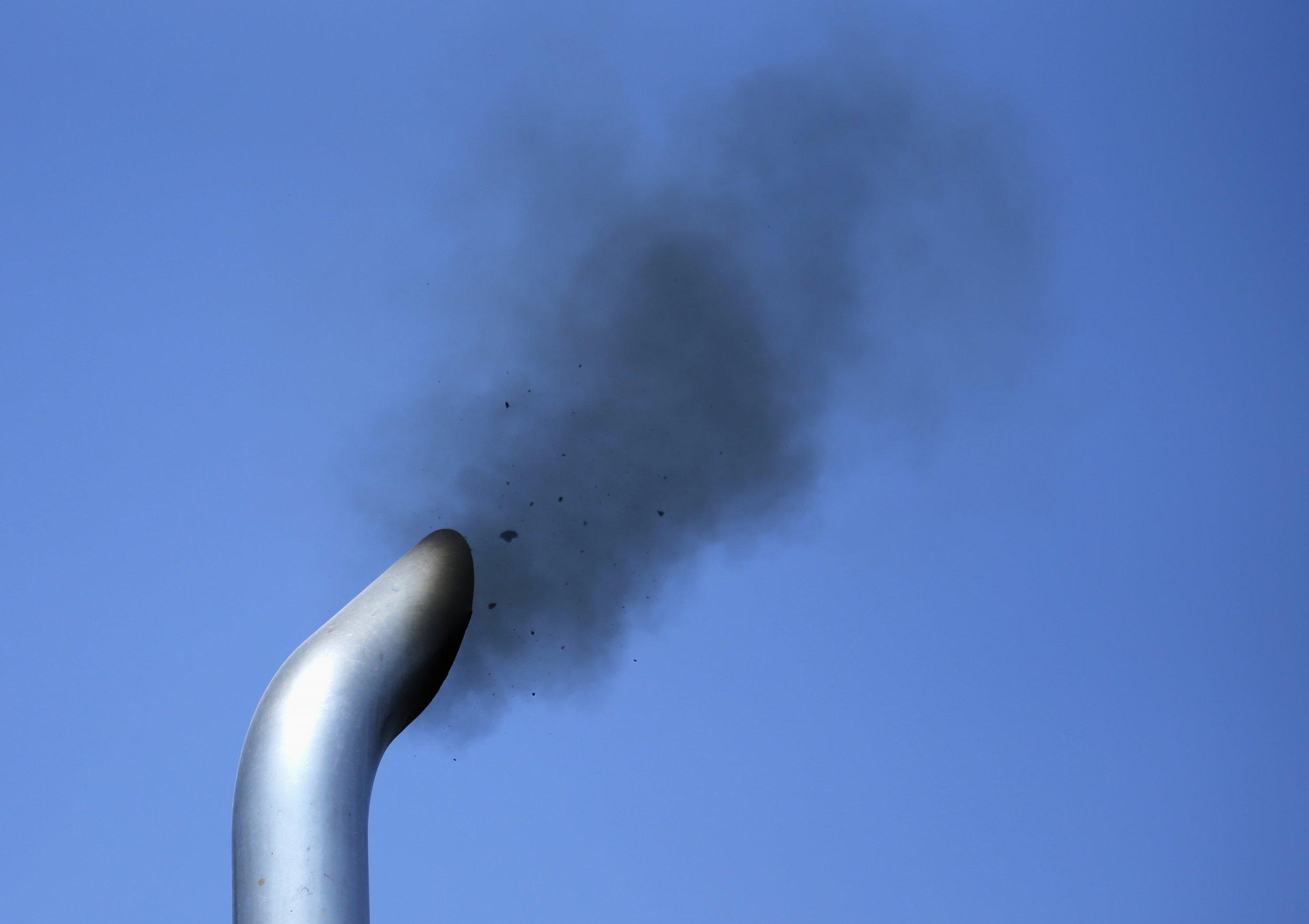 Truck exhaust pipe emits smoke