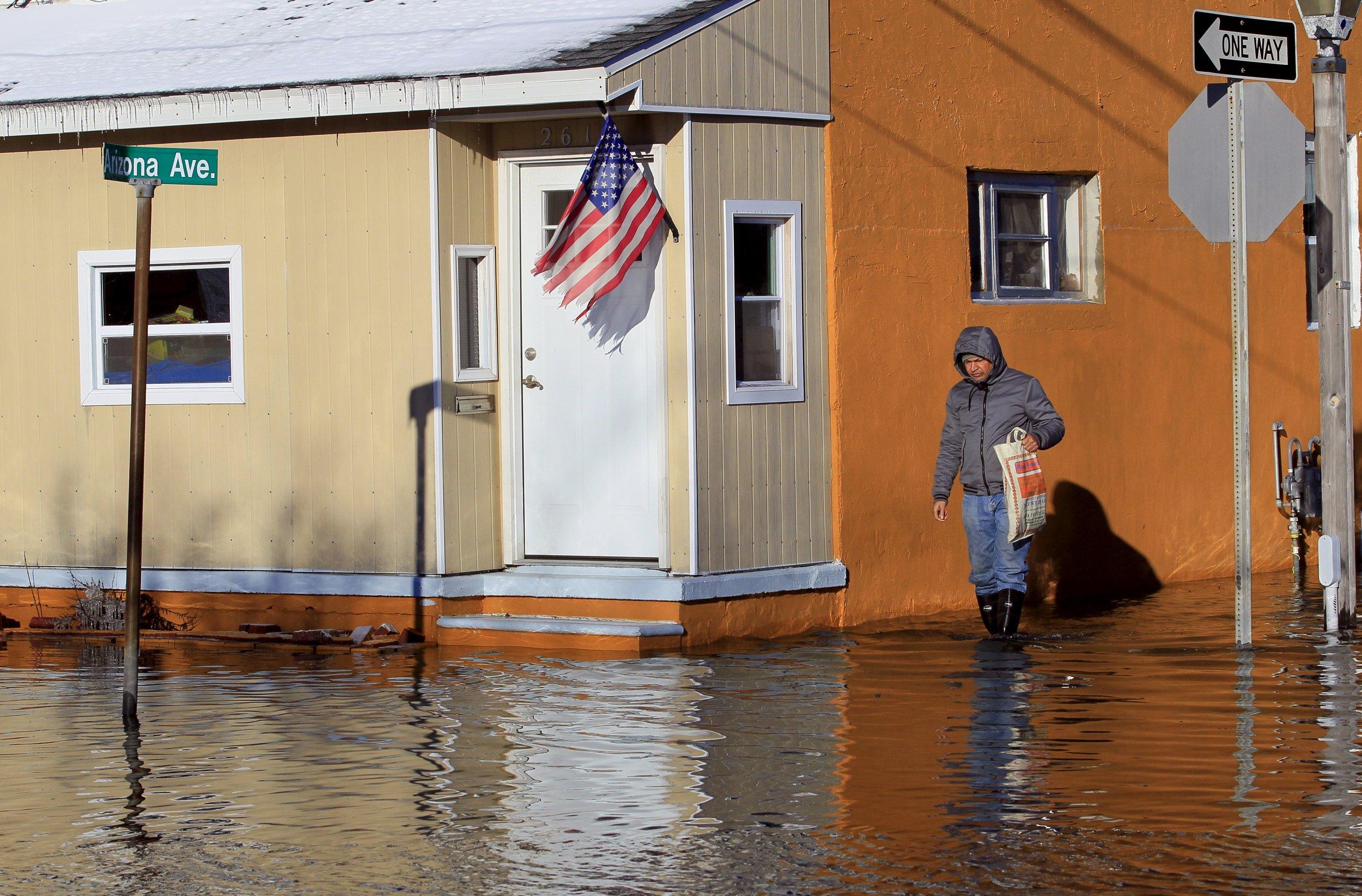 Man Wades Through Flooded Street