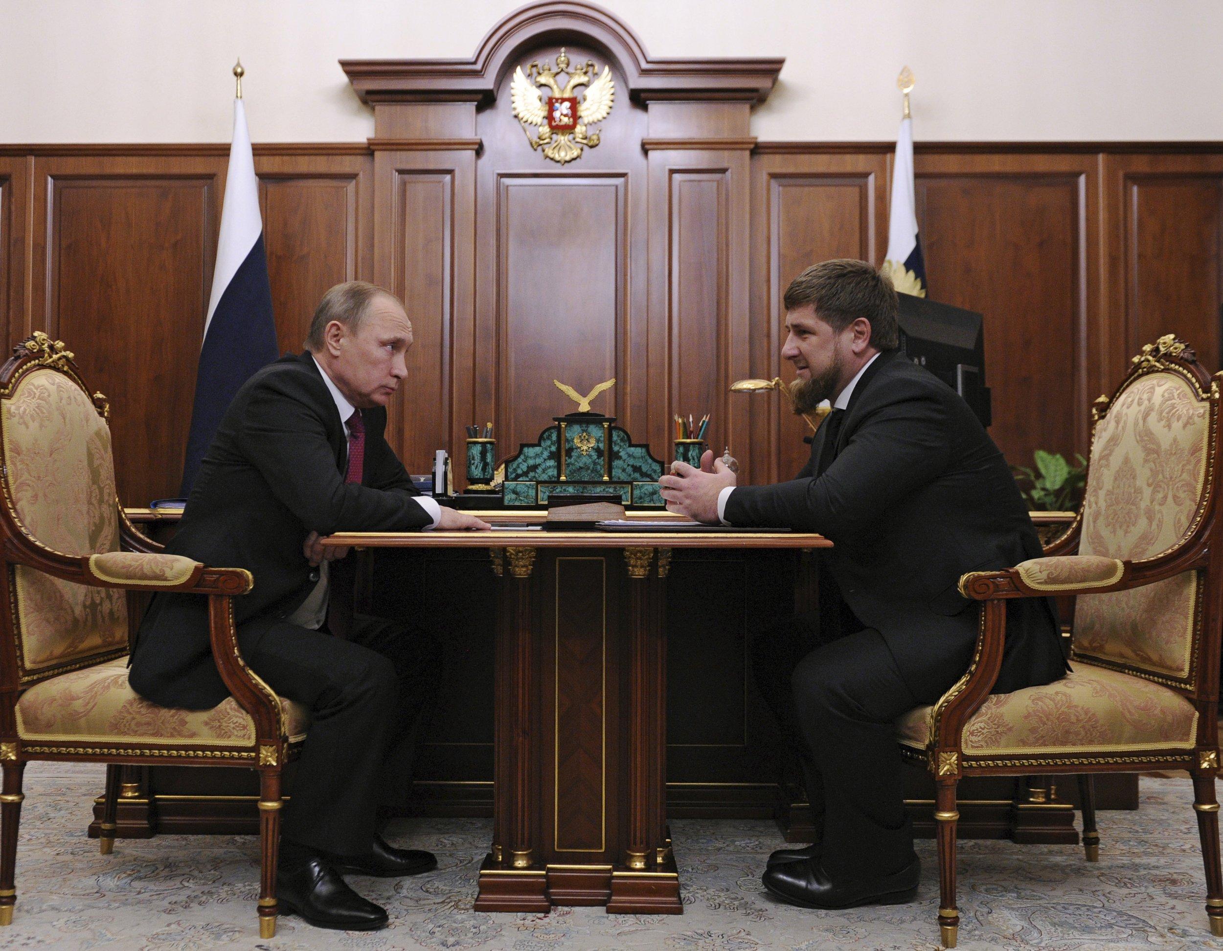 Putin sits opposite Chechen President Kadyrov