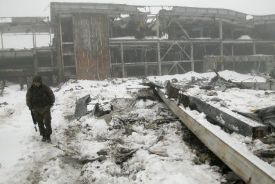 Rebel approached derelict building in the snow