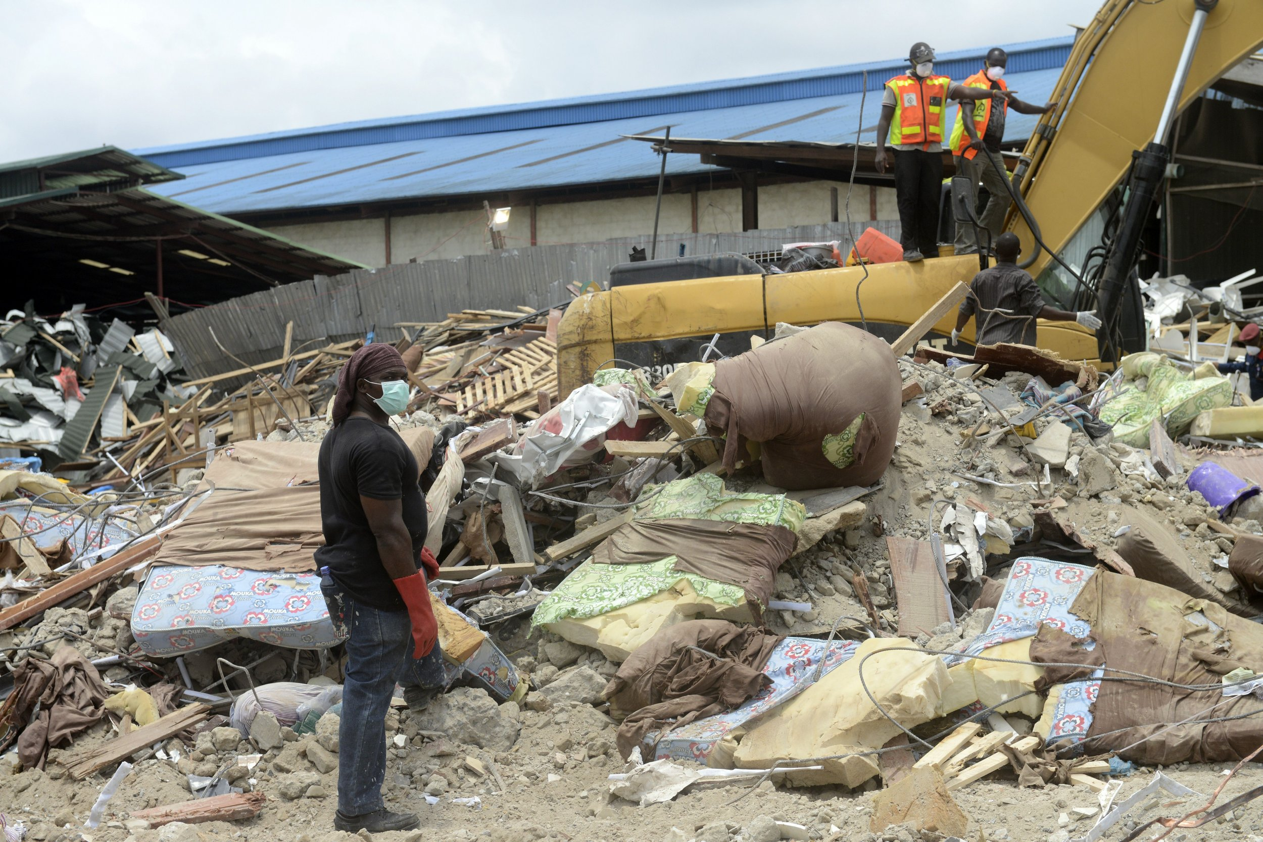 Rescue workers clear rubble from a collapsed church owned by TB Joshua's church in Lagos.