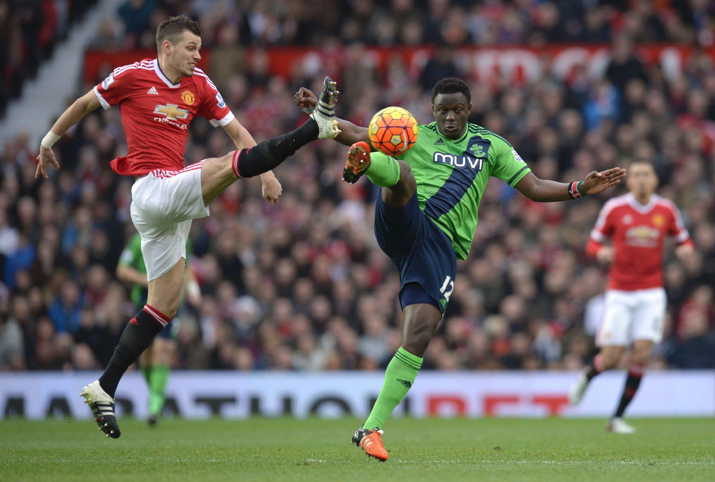 Kenyan midfielder Victor Wanyama challenges Manchester United's Morgan Schneiderlin.