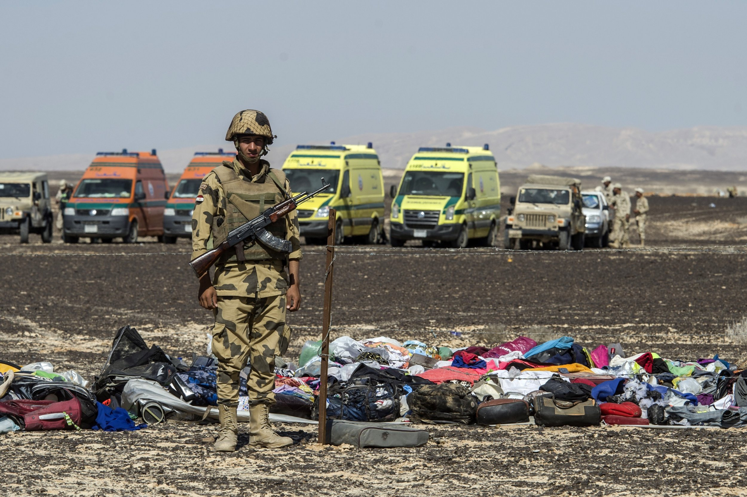An Egyptian soldier guards luggage of the victims of the Russian plane crash in Sinai.