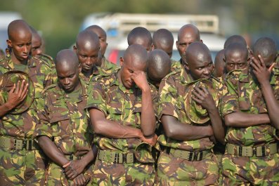 Kenyan soldiers attend a memorial service for victims of an Al-Shabab attack.