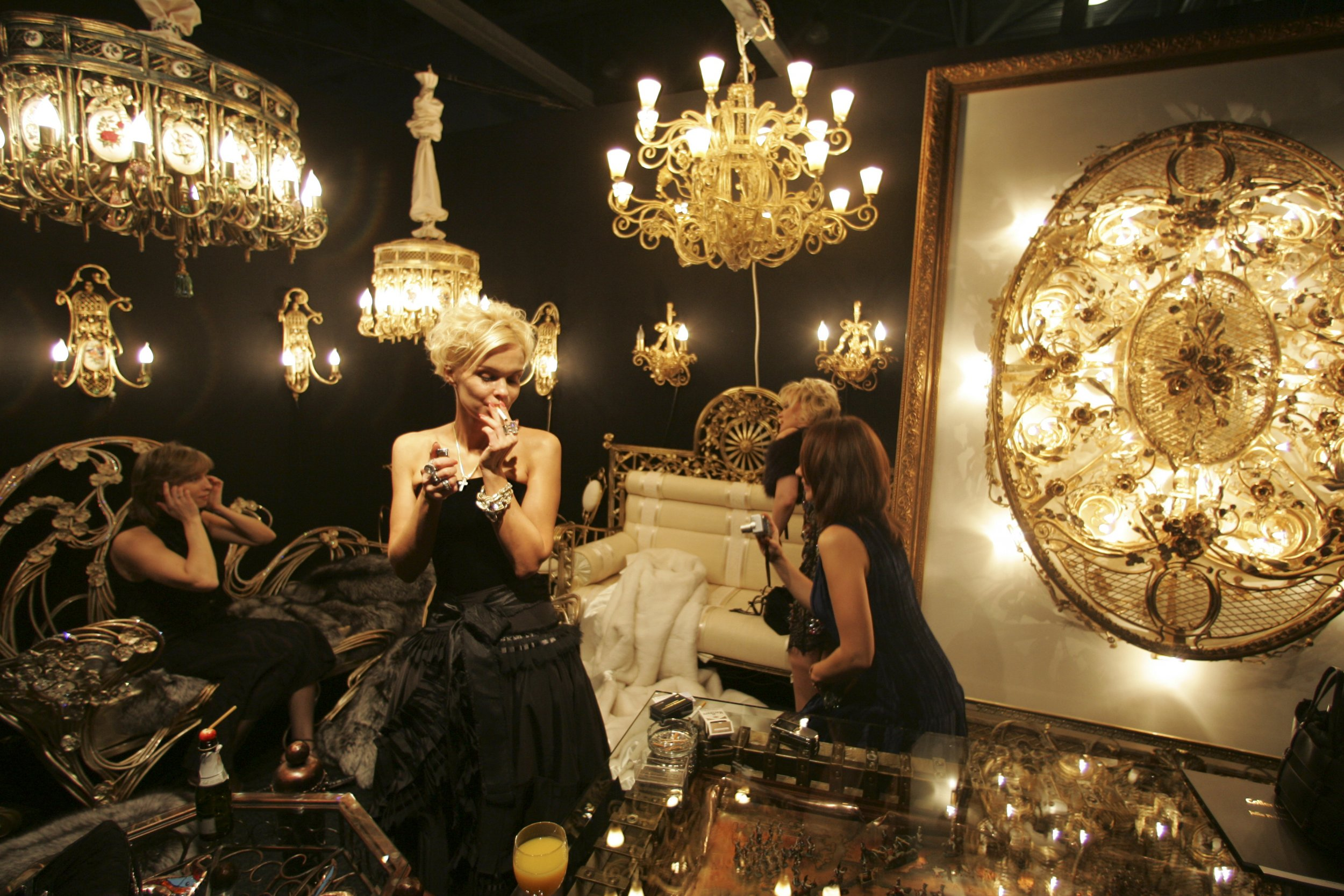Woman walks surrounded by golden luxury items