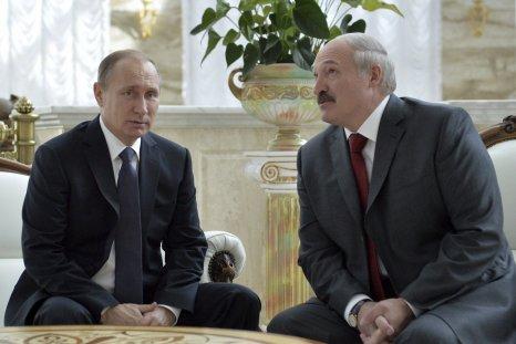 Putin sits next to Lukashenko
