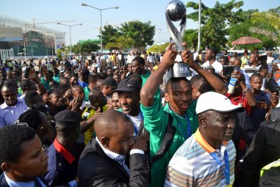 Nigeria's Golden Eaglets return to Abuja with the 2015 Under-17 World Cup trophy.