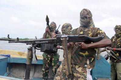 Niger Delta fighters prepare for an operation in Nigeria.