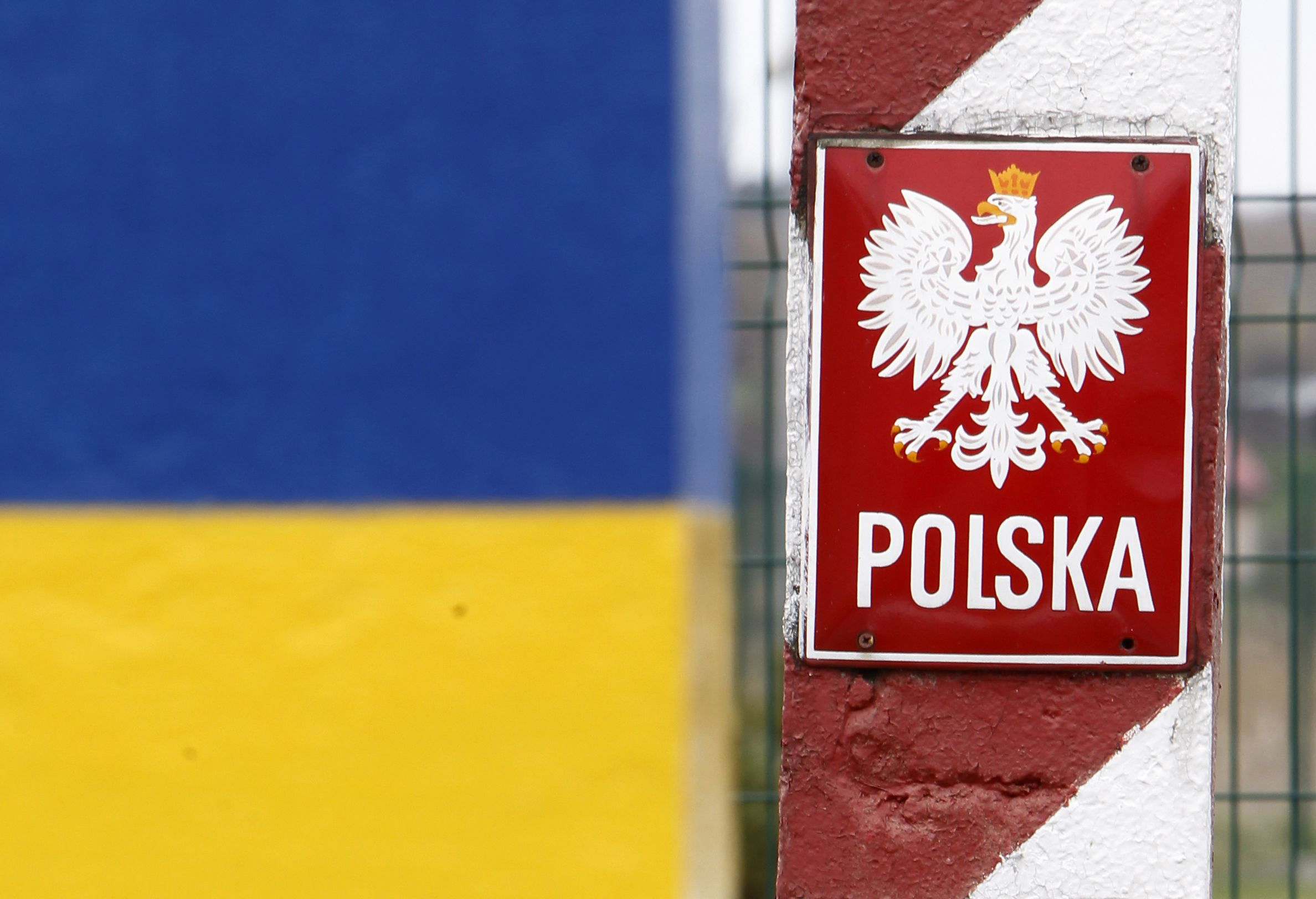Close up of Ukraine and Poland's border signs