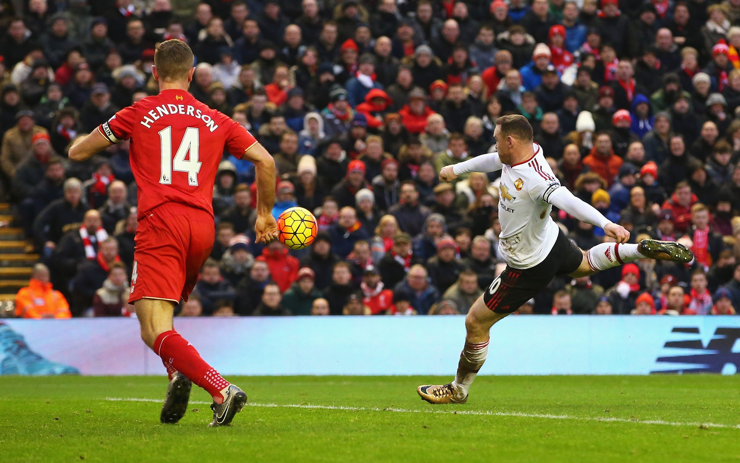 Wayne Rooney scores at Anfield on January 17.