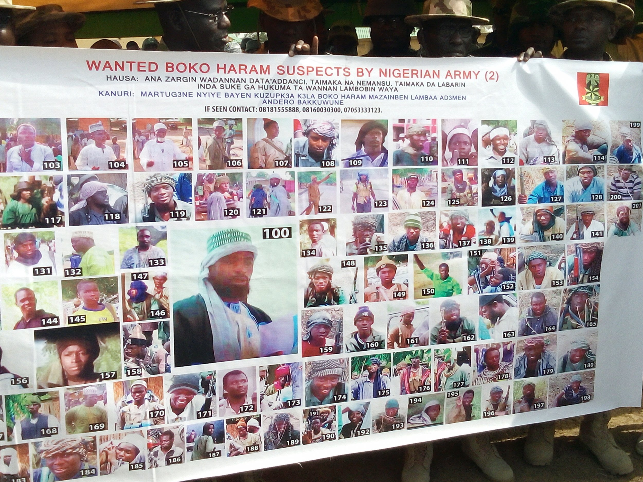 A banner shows 100 most wanted Boko Haram suspects.
