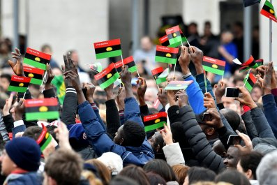 Pro-Biafra activists wave flags in St Peter's Square.