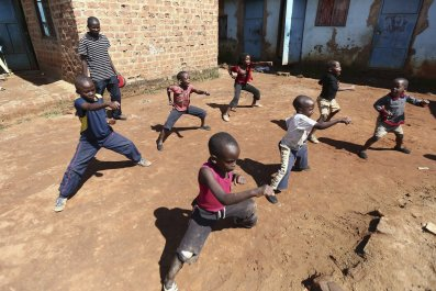Ugandan children rehearse in a martial arts class in Kampala.