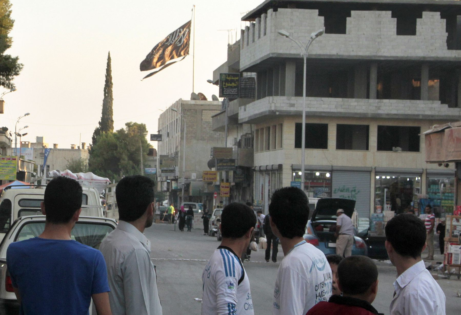 ISIS flag flies in Raqqa.