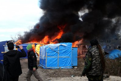 A hut burns in the Calais Jungle.