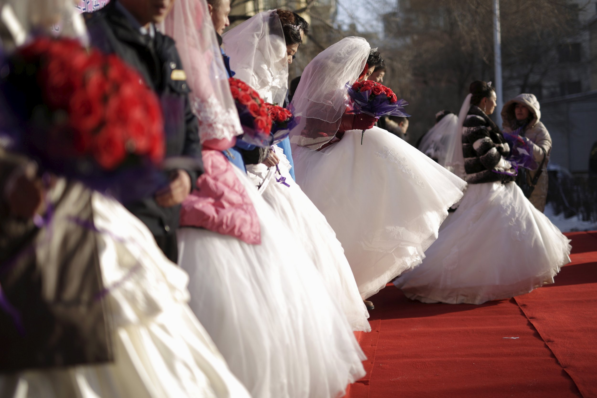 Chinese brides line up for wedding