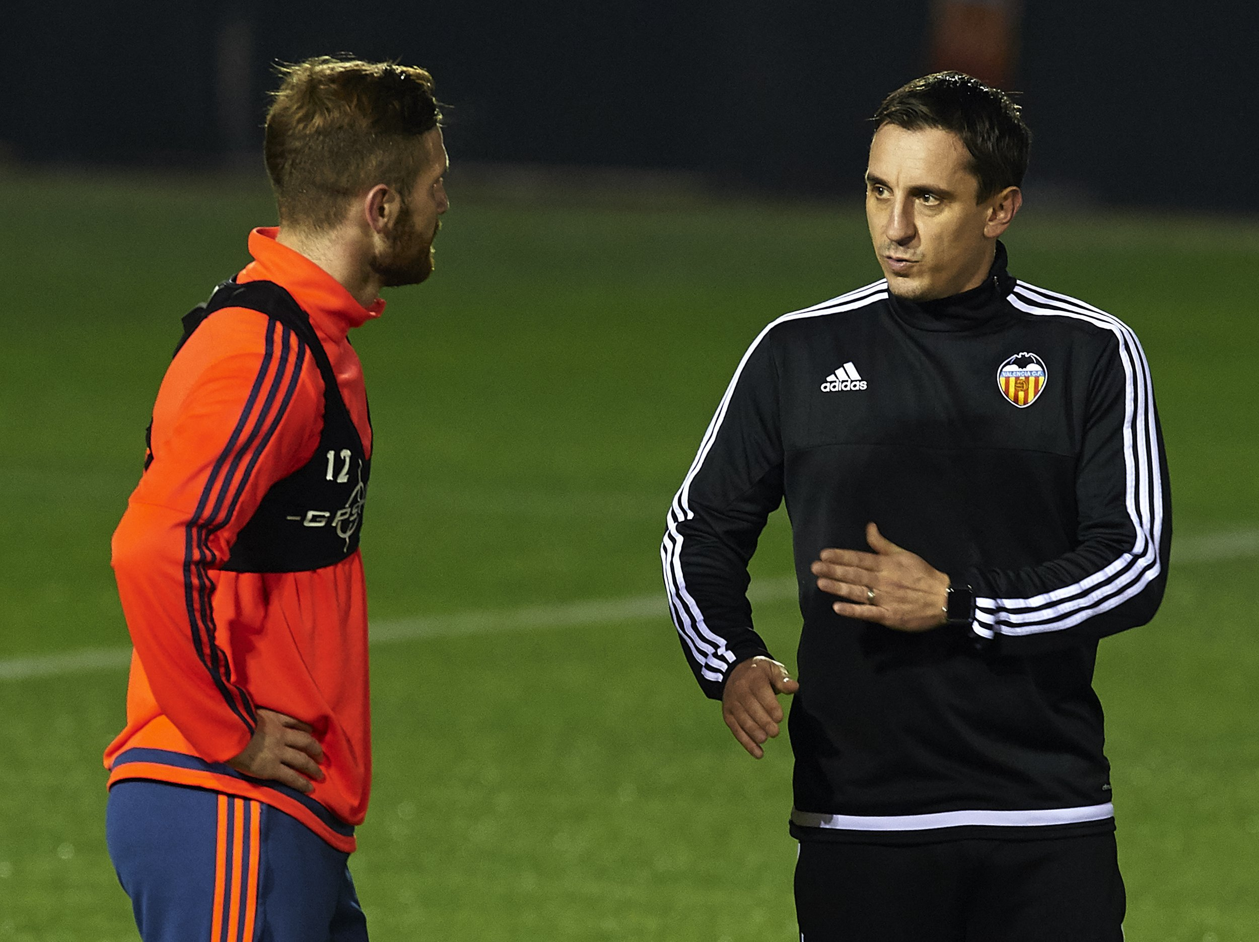 Gary Neville, right, talks to Shkodran Mustafi
