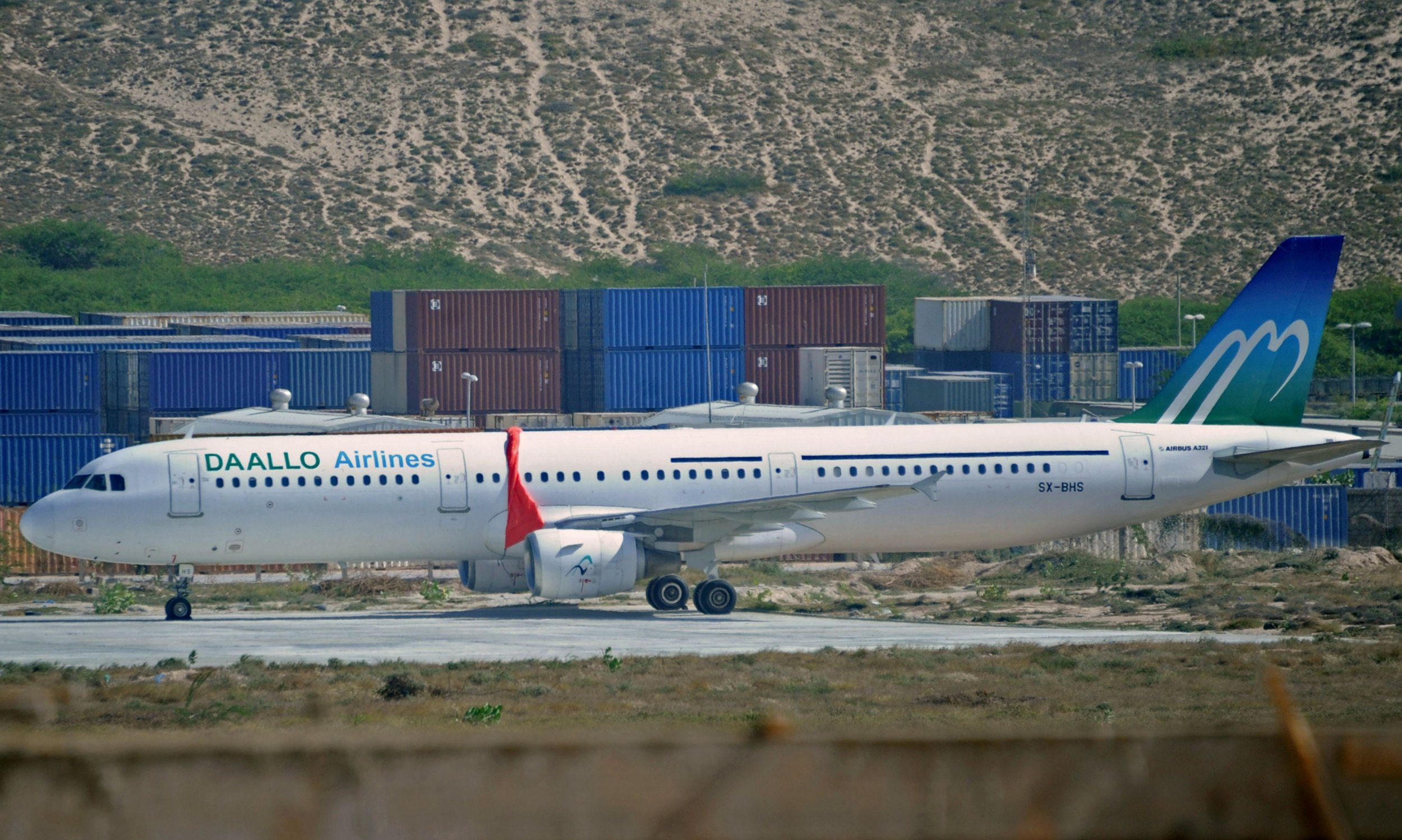 A Daallo Airlines flight sits in Mogadishu after Al-Shabab tried to blow it up.